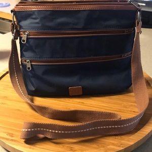 The Sak navy nylon handbag